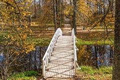 White wooden bridge, the Park of the estate Mikhailovskoye, Pushkinskiye mountains. RUSSIA, PSKOV REGION, MIKHAILOVSKOYE - OCTOBER 4: White wooden bridge, the Stock Image