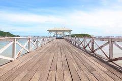 White wooden bridge into the sea Royalty Free Stock Photo