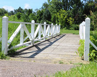 A White Wooden Bridge. Stock Photo