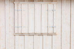 White wooden building wall on beach Stock Image