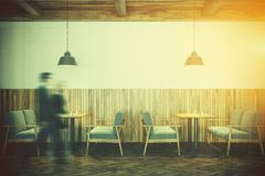 White and wooden cafe interior, sofas toned Stock Photo