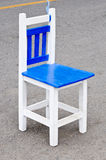 White wooden chair. On the street of university Royalty Free Stock Image