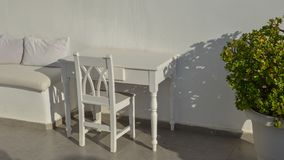 White wooden chair and table stock photography