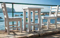 White wooden chairs and table Stock Photography