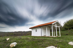 White wooden chapel. On the hill Royalty Free Stock Image