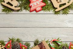 White wooden christmas background with fir branches, cones, decor, top view, copyspace. stock images
