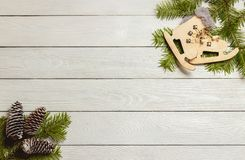 White wooden christmas background with fir branches, cones, decor, top view, copyspace. stock photos