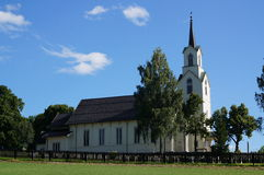 White wooden church and blue sky, Norway Stock Photography