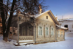 White wooden cottage house at winter Stock Images