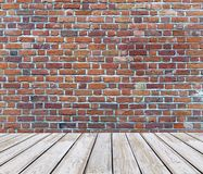 White wooden deck floor with red brick background. Close up stock image