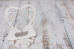 White wooden deer heart on free space rustic background Stock Image