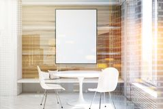 White and wooden dining room, table, poster toned. White and wooden dining room interior with a concrete floor, a round table with two white chairs standing near Royalty Free Stock Photos