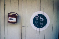 White wooden door with mail box and round open sign Royalty Free Stock Images
