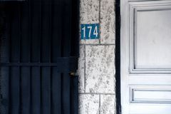 Number 174 sign on tile wall stock photo