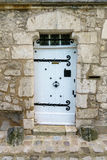 White Wooden Door in Stone Stock Photography