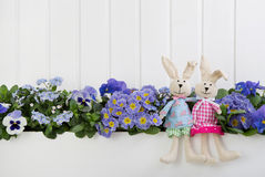 White wooden easter decoration with flowers and a pink bunny for Royalty Free Stock Photography