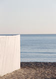 A white wooden fence against the sea Stock Photography