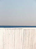 A white wooden fence against the sea Royalty Free Stock Photos
