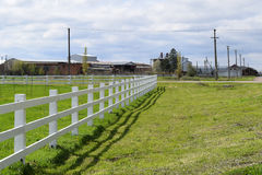 White wooden fence around the ranch Royalty Free Stock Photography