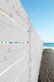 A white wooden fence on the beach Royalty Free Stock Photography