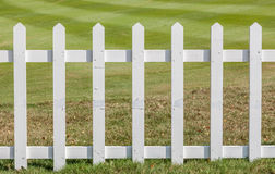 The white wooden fence with green meadow background. Royalty Free Stock Image