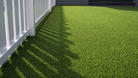 Free White Wooden Fence On Green Artificial Turf Surface In Front Yard Of Home Stock Image - 181408001