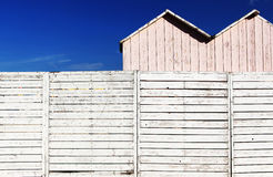A white wooden fence with some booths Royalty Free Stock Photos
