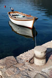 White wooden fishing boat floats moored Royalty Free Stock Image