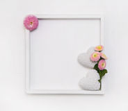 White wooden frame for a background or greeting card with two he Royalty Free Stock Image