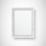 White wooden frame. Blank white picture frame on the white wall. Vector EPS 10 Format Stock Photography