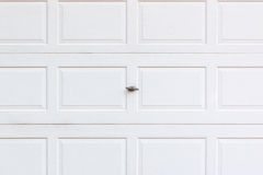 White wooden garage door with lock. Royalty Free Stock Photography