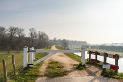 White wooden gate on a dike in the Netherlands Stock Photos