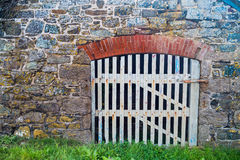 White wooden gate in an old cornish wall Royalty Free Stock Photo