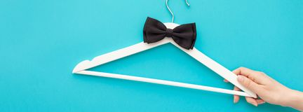 White wooden hangers on blue background royalty free stock photography