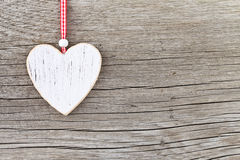 White wooden heart on a wooden board stock photography