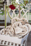 White wooden hearts decorated on white iron chair Stock Photos