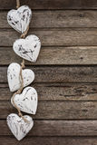 White wooden hearts on old brown wooden background Royalty Free Stock Photo
