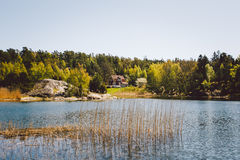 White wooden house on the lake stock photography