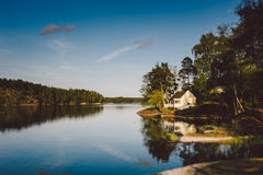 White wooden house on the lake royalty free stock photos