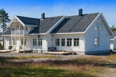 White wooden house in norway Stock Photos