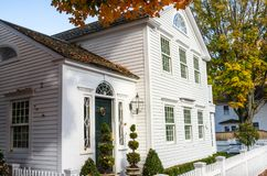 White Wooden House with a Traditional Green Wooden Door royalty free stock photos