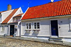 White wooden houses with red tile roof Stock Image