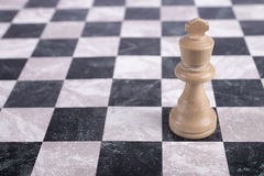 White wooden king on chessboard Royalty Free Stock Images