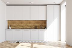 White and wooden kitchen interior Stock Image