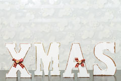 White wooden letters on brown wooden table forming word XMAS wit Stock Images