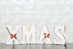 White wooden letters on brown wooden table forming word XMAS wit Royalty Free Stock Photos