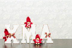 White wooden letters on brown wooden table forming word XMAS wit Stock Image