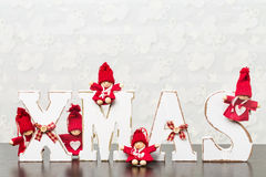 White wooden letters on brown wooden table forming word XMAS wit Royalty Free Stock Photography