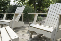 White wooden lounge chairs Royalty Free Stock Image
