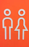 White Wooden Man and Woman Restroom Icon on Orange Wall Background Stock Photography